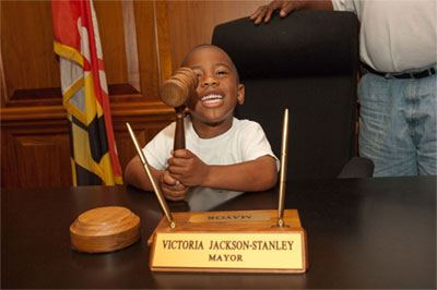 Boy at Mayors Desk